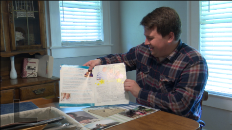 Pace Tyson shows an article he wrote after his father died of early onset Alzheimer