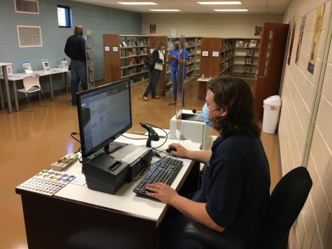 Rod Stone, assistant branch manager of the new Bloomfield Library, checks his computer Friday at the new facility in the old Gilead Christian Academy that is now the Gilead-Bloomfield Recreation Center.