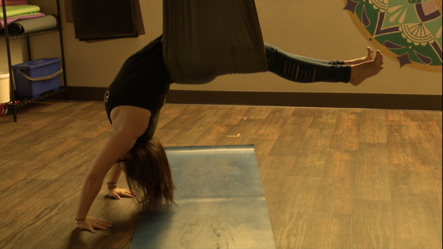 Sparks Yoga owner Christa Conn found peach during the pandemic by practicing yoga.