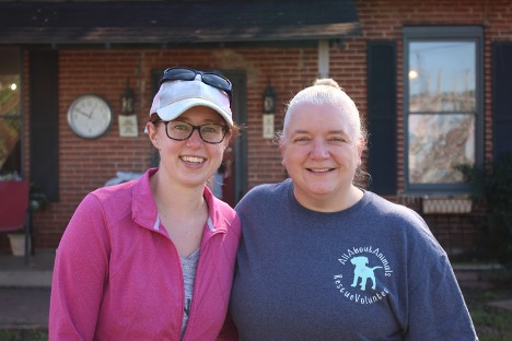 Haylee Robinson and Kristin Wright volunteer at All About Animals, a nonprofit no-kill shelter in Macon, Ga. on Nov. 14.