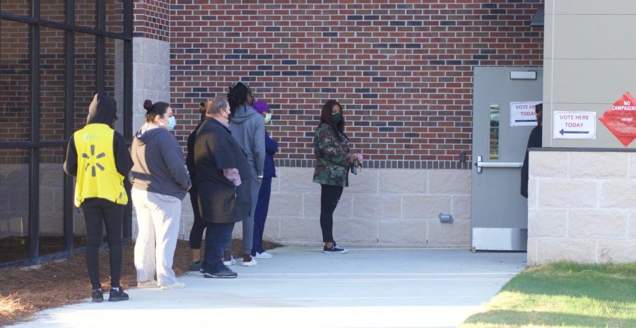 Voters waiting in early morning line at Macon's Appling Middle School precinct on Nov 3.
