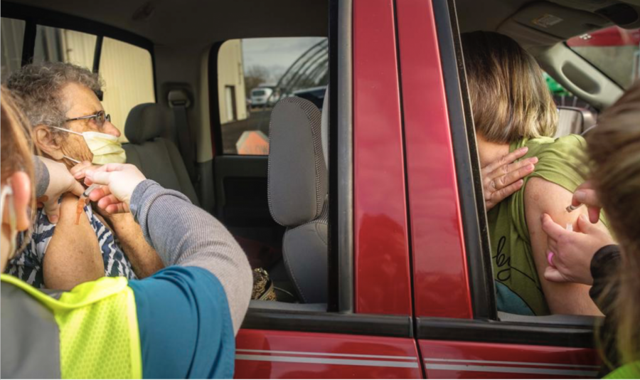 People receiving shots during a recent drive-thru vaccine event in Cochran.
