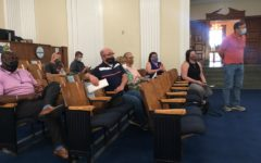 Neighbors opposed to the Travel Centers of America truck stop on Sardis Church Road voice  frustrations during a delay in Mondays hearing at Macon-Bibb County Commission chambers.