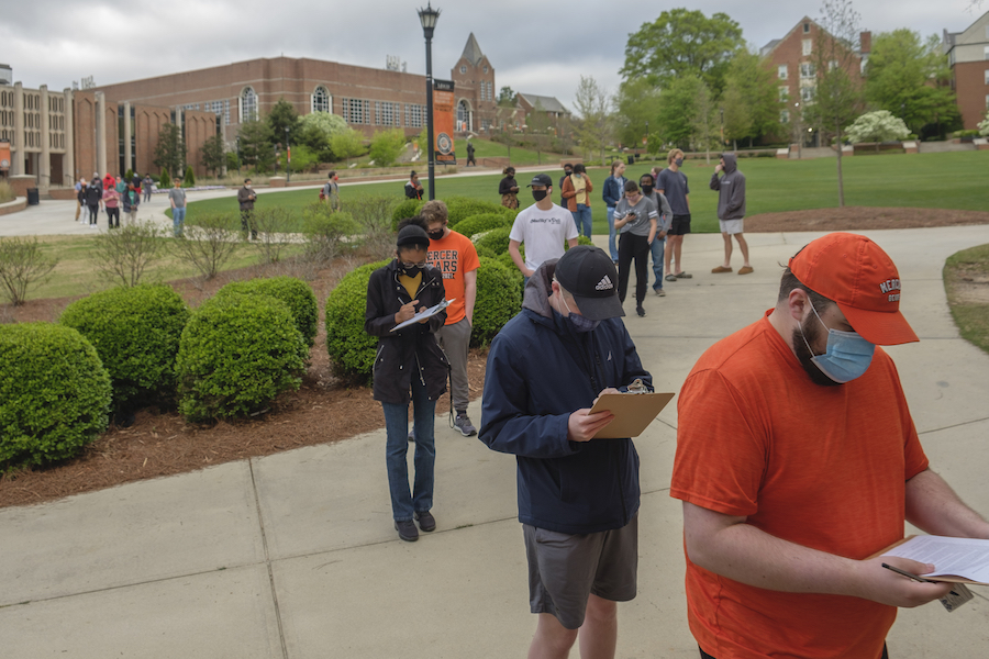 Students, staff and faculty at Mercer University lined up for no appointment vaccinations in a historic basketball gymnasium after the school to receive the Pfizer COVID-19 vaccine.