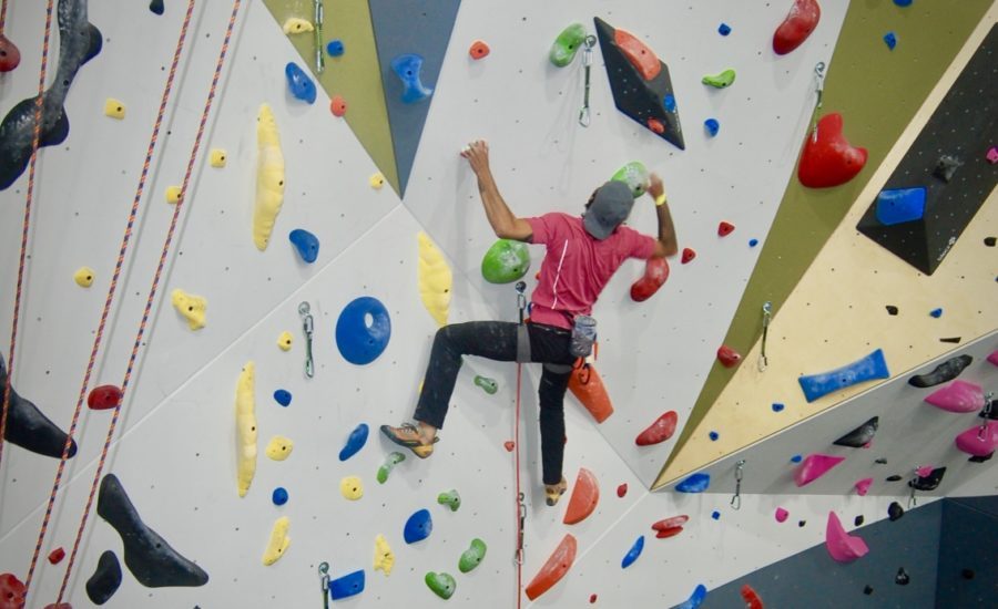 Florida-based Climber Steven Olivo reaches for the next hold on his green free-climbing route.
