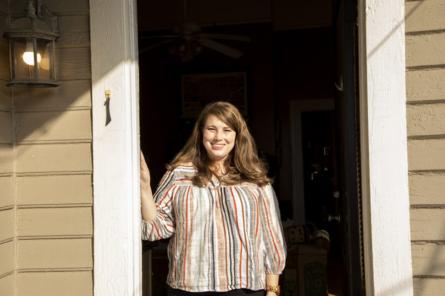 """Emily Hopkins poses for a portrait outside the apartment she has rented or 7 years in Macon, Ga. She is starting the home buying process. """"There are so many really cool unique houses in Macon and really vibrant and exciting neighborhoods,"""" she says, """"It"""
