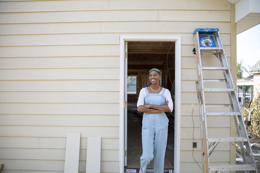 """Tonja Khabir poses outside of the home she is building in Pleasant HIll. The home buying process means a lot to Khabir. She attributes the work of her mother and her grandmother is helping her become who she is today, in helping her get to this point in her life. """"Everything that I"""