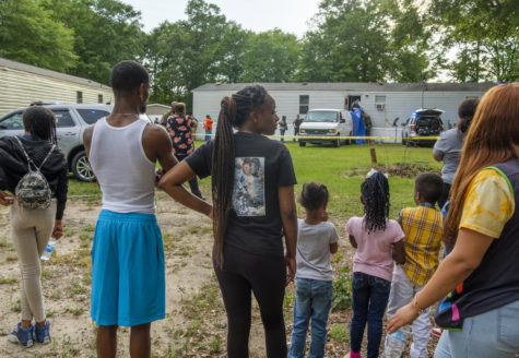 Family and neighbors of Quinterious Hillman and Jerod Lester watch as Bibb County Sheriff