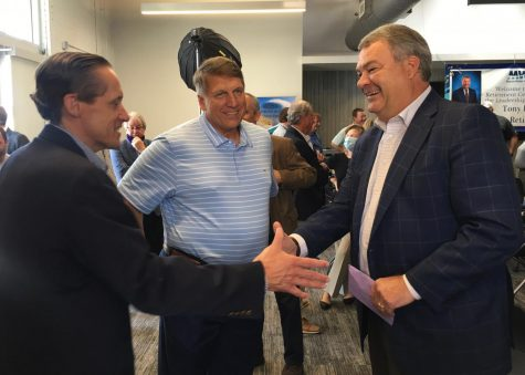 Macon Housing Authority CEO Mike Austin, left, shakes hands with former Macon Water Authority executive director Tony Rojas during his retirement celebration last month.
