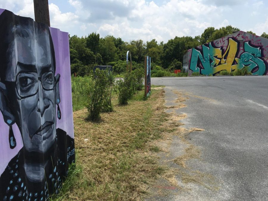 The likeness of the late Supreme Court Justice Ruth Bader Ginsberg keeps watch at the Triangle Arts Center in Macon's industrial sector.