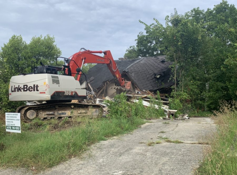 One of the houses being demolished next to the community center after the press conference