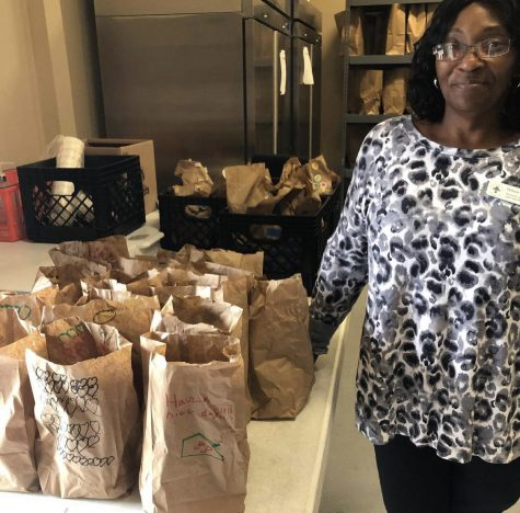 Valerie Sewell, the director of operations at Loaves and Fishes Ministry, getting ready to serve a lunch that was provided by a children's group, according to Jake Ferro.
