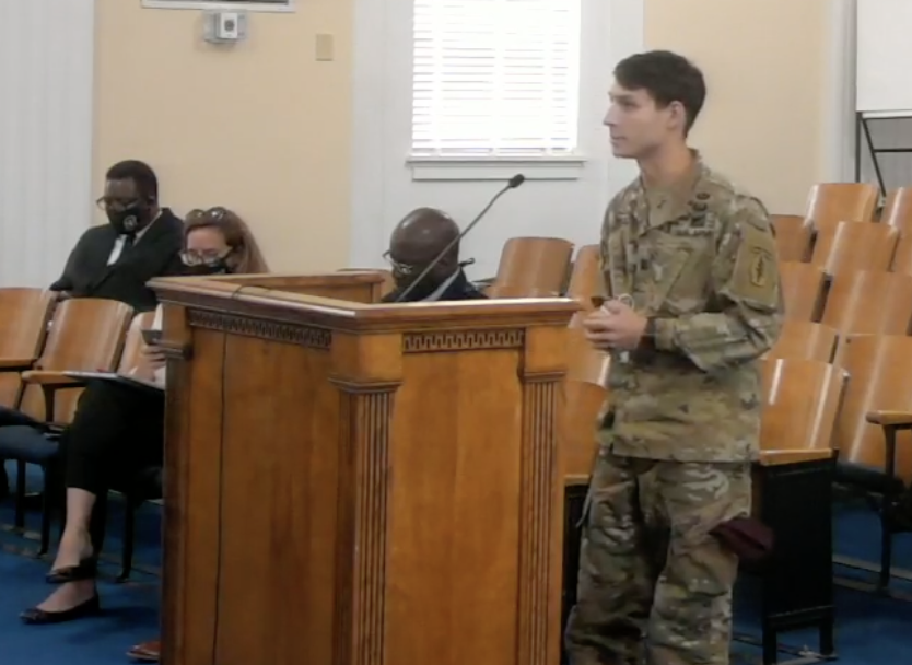 U.S. Army Capt. Hunter Mentz tells Macon-Bibb County's mayor and commissioners how his unit will help the county fight violent crime.