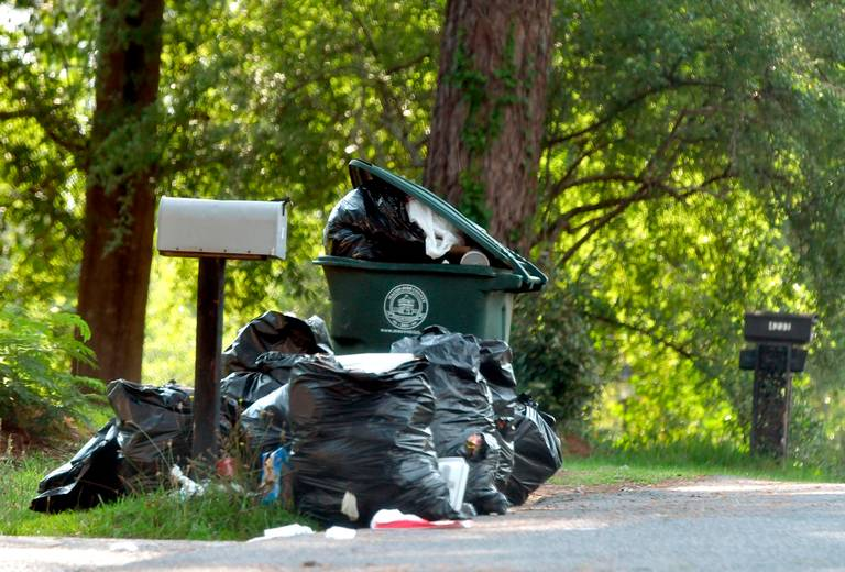 Garbage piled up outside a residence on Laura Ann Place in Macon June 18