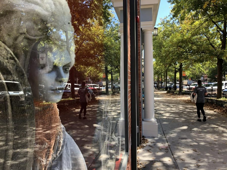 A ghostly image peers from a Cherry Street business window. Downtown Macon hosts trick-or-treating Sat., Oct. 30 and a variety of activities before Halloween.