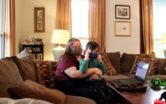Lane Hinson hugs her son, Lennox, in their home in Macon, Ga.