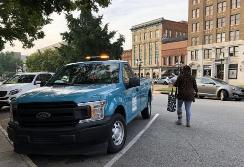 Downtown Macon ambassadors, who cruise around in this blue pickup, help keep streets clean and safe.